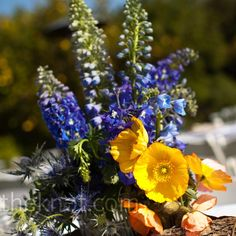 Blue and Yellow Centerpieces but switch out the poppies for daffodils or yellow roses.