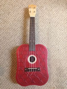My first ukulele build. Made with parts from C.B. Gitty and a large, deep, cookie-tin. See more at my blog: http://buckdawson.blogspot.com/2016/08/two-ukes-kalima-and-can-jo-walked-into.html