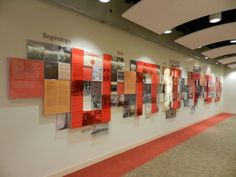 """panels - The """"Wall of History"""" at United Way of Greater Los Angeles' downtown office, chronicles the history of the organization in 1924 from itsbeginnings as The Community Chest to a leader in fighting poverty in Los Angeles County. Wayfinding Signage, Signage Design, Exhibition Display, Exhibition Space, Environmental Graphics, Environmental Design, Office Graphics, Donor Wall, Office Branding"""