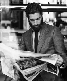 Newspapers, beards and suits - how perfect!