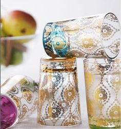 Moroccan style exploded in popularity a few years back and like the original designs themselves, it has proved it has staying power. Exotic and intricate, these gold glasses from Horchow are a luxurious treat to add to your loved one's barware.     Four assorted 6.75-ounce tea glasses   Set includes one each in purple, amber, turquoise, and green. Made in Turkey. Hand wash.