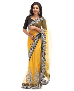 Net Fabric. Body is Yellow color net with stones along with border, Designed skirt portion with stones with saree border. Black color velvet border designed with stones. Pallu is Yellow color net with stones with saree border. Yellow color net with stones designed on the sleeves n the back portion of the blouse.