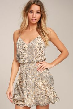 c8529d0047 Get cocktails in style with the Tanis Beige Print Skater Dress! Lightweight  print chiffon shapes