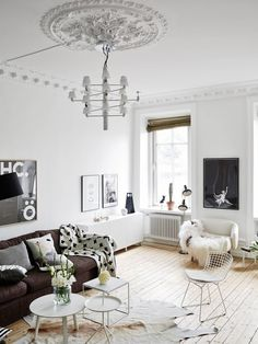 Tricks of the Trade: How Designers Warm Up Black & White Rooms this room, from Planete Deco, mixes in a few shades of grey along with the black and white. Interesting textures (wood, the ceiling medallion and cowhide rug) also help to warm things up. Home Design Decor, Best Interior Design, Interior Design Inspiration, Home Decor Inspiration, House Design, Interior Work, Interior Styling, Living Room White, Home Living Room