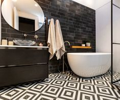 Chlo & Em's Bathroom Pairing three bold tiles together is a brave move, but when done correctly creates a breathtaking space! Tiles used: Feature Wall: Diesel Camp Rock Black Mix Floor: Goroka Grafito Wall: White Satin Herringbone Mosaic Bathroom Floor Tiles, Wall Tiles, The Block Nz, Herringbone Wall, Bungalow Renovation, Inside Home, Steam Showers Bathroom, Family Bathroom, Decorative Tile