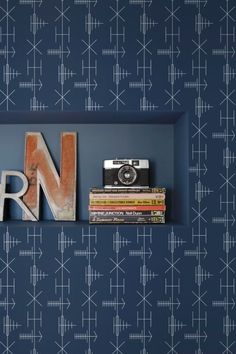 An unusual yet highly effective linear graphic Mini Moderns wallpaper design featuring mid-century television aerials.
