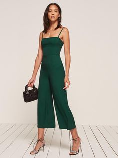 This is a forest green straight neck jumpsuit with a tight fitting bodice and a wide leg from Reformation. Emerald Green Jumpsuit, Mode Outfits, Fashion Outfits, Wedding Jumpsuit, Formal Jumpsuit, Short Jumpsuit, Jumpsuit Outfit, Denim Jumpsuit, Jumpsuits For Women