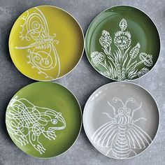 West Elm plates, designed by Sesame Letterpress. It's taking all my willpower to resist buying these. $20