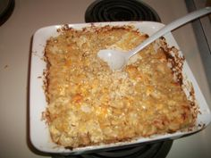 Boil elbow macaroni for half the time mentioned on the box then drain; shred one block of cheddar cheese; dice a small onion; mix macaroni with one cup of sour cream and one cup of cheddar and two tbspns of dijon mustard with the onion; add cracked pepper; place in pre-heated oven at 350 degrees for 15-20 min. Then mix another cup of cheese and 1/4 cup of sour cream with the macaroni and place back into the oven for remaining 15-20 min. When it is done, sprinkle more black pepper if needed.
