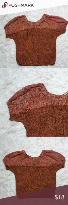 Ann Taylor Short Sleeve Peasant Top Sz Small Ann Taylor Animal Print Rust Orange Short Sleeve Peasant Top Size Small. Has an illusion neckline and elastic hem. Key hole opening at back of neck. In good condition. 100% rayon 100% polyester . Machine wash cold. Fast shipping same or next business day. Measurements Flat: Pit to Pit: 23.5 in Bust: 27 in Waist: 43 in  Length: top to bottom 24.5 in Ann Taylor Tops Blouses