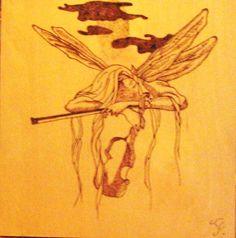 Sogni e musica. Quadro realizzato con la tecnica della pirografia, su legno.  Toni Fisco