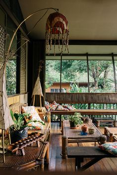 Art and native elements, colorful pillows, Wendy's bamboo-and-paper lamps make this airy and cozy room inviting. Bamboo House Design, Tropical House Design, Tropical Interior, Tropical Style, Tropical Houses, Filipino Architecture, Bamboo Architecture, Architecture Design, Philippine Architecture