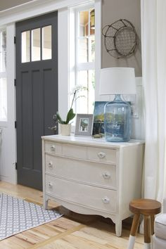 I love how this entryway is styled - also like the paint color.