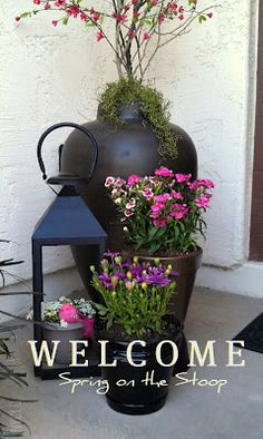 Welcome Spring on the Stoop - container gardening -front porch display with lantern and flower pots Container Plants, Container Gardening, Gardening Tips, Jardin Decor, Welcome Spring, Porch Decorating, Garden Pots, Porch Garden, Garden Inspiration