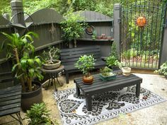 Rustic Look  Fence and furniture seem the perfect color to enhance the restful ambiance of this small patio.