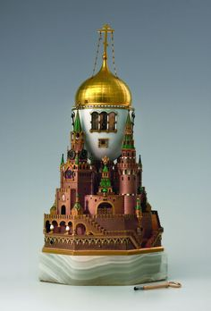"""The Moscow Kremlin"" Egg (561 KB). Presented by Emperor Nicholas II to his wife, Alexandra Feodorovna, at Easter 1906. Saint Petersburg, between 1904 and 1906. House of C. Fabergé. Gold, silver, onyx, glass, glimmer, enamel of guilloche ground, enamel paint, oil paint; h. 36,1 cm (incl. base), base: 18,5 х 18,5 cm © The Moscow Kremlin State Historical and Cultural Museum and Heritage Site."