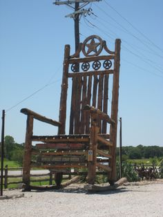 """Lipan, Texas: The Star of Texas: Giant Rocking Chair. The """"Star of Texas"""" rocking chair stands 26 feet tall. It's labeled as the World's Largest Cedar Rocker. It was created by Texas Hill Country Furniture and Mercantile."""
