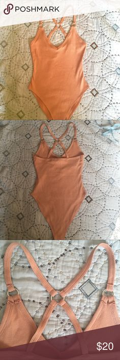 💙🍑forever 21 ribbed bodysuit🍑 Sweet racer back ribbed bodysuit. Pretty back with silver hardware. Pretty coral color🍑 NWT Forever 21 Tops
