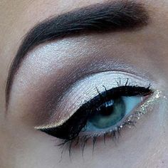 Shimmery white and purple shadow. Cat eye.