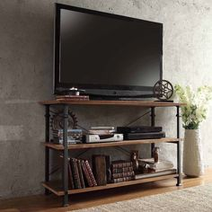 Find the ideal home for your television with this Myra vintage industrial TV stand from Tribecca Home. Featuring a black sand metal frame supporting three wood shelves, this TV stand adds rustic charm Industrial Tv Stand, Rustic Industrial, Industrial Storage, Industrial Lamps, Pipe Furniture, Industrial Furniture, Furniture Vintage, Reclaimed Furniture, Smart Furniture