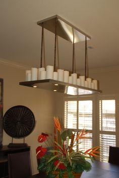 I love the pillar candle rectangular chandelier at restoration electric candle chandelier aloadofball Images