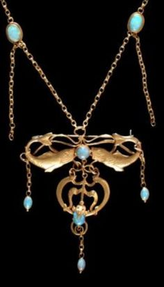 An Arts and Crafts gold and opal necklace, by Edgar Simpson, Nottingham, England, circa 1910. #EdgarSimpson #ArtsAndCrafts #necklace