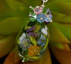 Medaw flowers and butterfly pendant Floral by FireMonkeyCreations