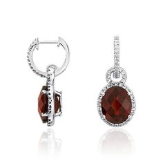 Truly sparkling, these gemstone earrings feature oval-cut garnets and round white sapphire gemstones pavé-set in a drop design of sterling silver.