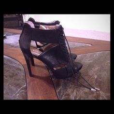 Bcbgeneration heels! Black leather upper heels with zipper in back and strings in the front of shoe! These shoes are brand new! Gorgeous Shoe! No trading, low balling! Price is firm! NWOT!!! BCBGeneration Shoes Heels