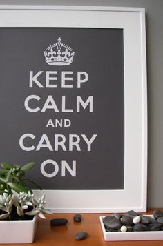 """So many variations of the """"Keep Calm and Carry On"""" poster to choose from. I like the greys in combination with wood."""
