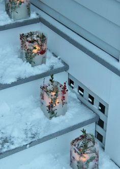 DIY Laternen aus massivem Eis schmücken die Außentreppe-Ideen für Außenbeleuchtung
