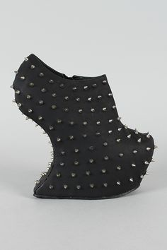 Goddess-06 Studded Spike Heel Less Curved Wedge Bootie $56.10