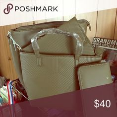 A brand new tote bag This olive green tote bag is not just one tote bag but it has four different bags in one. Bags Satchels