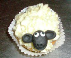 Scolpt Sheep head on ganache topped cupcake