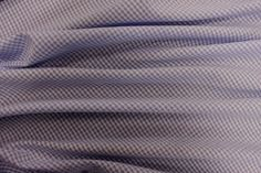 Blue Seer-Sucker Gingham  DOUBLE CHECK THIS IS COTTON! A good handle cotton gingham  100% cotton  112cm wide  Made in Indonesia  £4.99 per metre