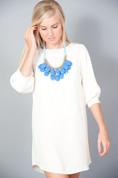 Would wear this with colored skinny jeans and a cute heel. Super cute necklace and blouse.