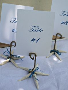 Set of 10 Beach Themed Wedding Table Number Holders - Starfish With Ribbon. $35.00, via Etsy.
