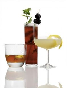 Sicilian Margarita: Tequila, Solerno Blood Orange Liqueur, Lime Juice, Simple Syrup, Pink Grapefruit Juice, Lime Slices.