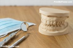 Dental mold showing the teeth of the upper and lower jaw with dental tools and a face mask on a wooden table in a dental care and examination concept Poster Dental Posters, Dental Office Decor, Poster Poster, Mousepad, Wooden Tables, Dental Care, Pune, Dentistry, Teeth