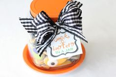 Jack o'lantern in a jar...bake and decorate cookies shaped like parts of a Jack O'lantern. Then gift them with the idea that the recipient can make cute jack faces before eating the cookies.