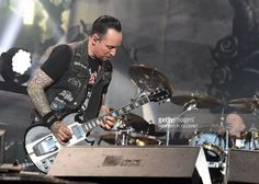 Singer and guitarist Michael Schøn Poulsen of the band 'Volbeat' performs at the 'Red Stage' during the 'Nova Rock 2016' Festival on June 11, 2016 in Nickelsdorf. / AFP / APA / HERBERT P. OCZERET / Austria OUT