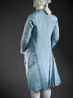 Back view, 3-piece suit, France, c. 1765. Ice blue silk faille with silver metallic-thread passementerie.