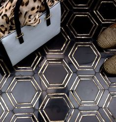 Happy for hexagons  How hot is the 'Helix Gold' marble tile? #blackandgold #marble #hexagon #mosaic #black #nero #hext #tilework #katespade #blackandwhite #shoes #homestaging  #florortile #walltile #designer #handbag #leopard  #tileaddiction #tiletuesday #interirordesigner  #hexy  #helix #gold #dreamdesign #tilelover #tiledesign #hex #goldaccents #glasstile #photography by tilebar