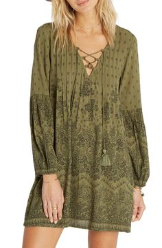 Delicate pleats frame a flirty lace-up neckline on this crinkle gauze peasant dress printed with boho-chic paisley scrolls and finished with billowy bishop sleeves. Pair with a wool hat and booties for a cute fall look.