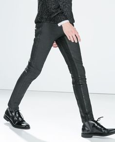 BLACK COATED TROUSERS WITH KNIT DETAILS from Zara