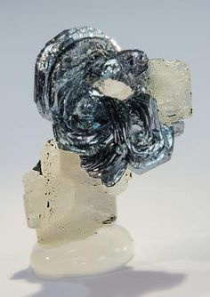 Hematite on Adularia - Monte Prosa, Central St. Gotthard Massif, Tessin (Ticino), Switzerland Size: 3.3 x 2.2 x 1.3 cm