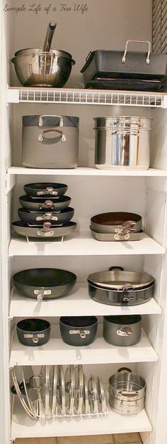 That stackable pot rack would be good for cast iron pans! A Storage Cabinet for Pots and Pans   Tiny Homes