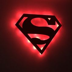 "Perfect for Superman fans and for children's play rooms or bedrooms. Some may even use this as a Superman night light! This wall cutout is precision machined with a CNC router out of 1/2"" wood. It is then painted with blue edges and a red face. This unit has optional red or white LED lights. www.addictedfurnishings.com"