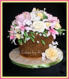 A beautiful basket cake with stunning, I mean AB-SO-LUTE-LY stunning, gumpaste flowers.