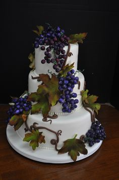 Perfect for your winery wedding, this 3-tiered fondant covered cake is dripping with sugar grapes and leaves.